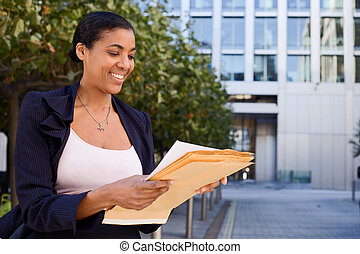 business woman reading letter