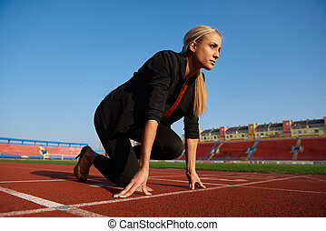 business woman ready to sprint