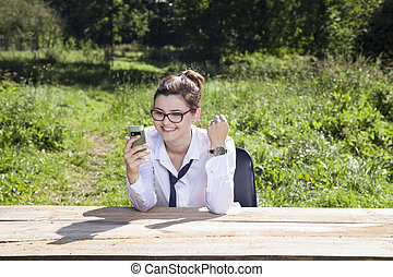 business woman rejoicing news on the web