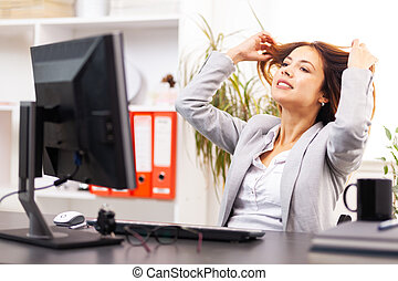 business woman relaxing in an office