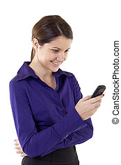 business woman sending a text message on her mobile phone -...