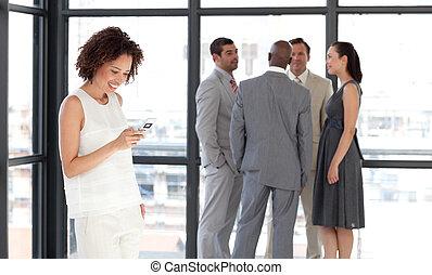 Business woman sending a text message - Potrait of a...