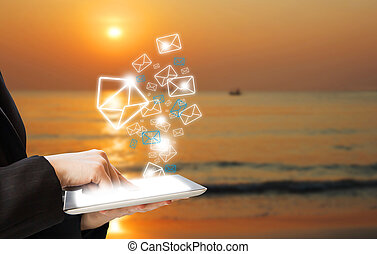 Business woman sending email marketing morning at sea