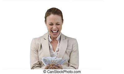 Business woman shaking a fan of cash