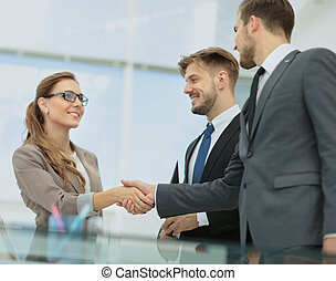 Business woman shaking hand to her partner - Happy smiling...