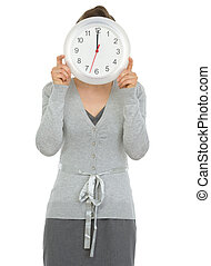 Business woman showing clock in front of face