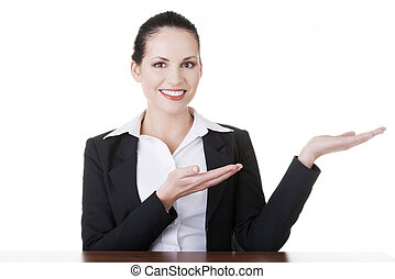 Business woman showing copy space on her palm