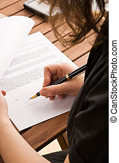 Business woman signing a contract