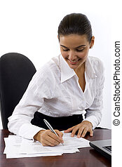 Business Woman signing documents in a modern office
