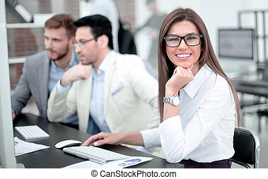 business woman sitting at the office Desk