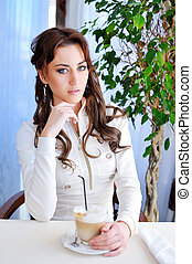 Business woman sitting by table