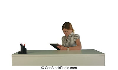 Business woman sitting in her office using a tablet computer on white background isolated