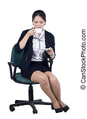 Business woman sitting in office chair with a cup of coffee