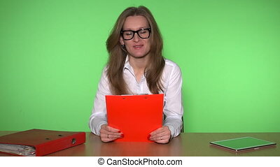 Business woman sitting in office with clipboard and consulting customer