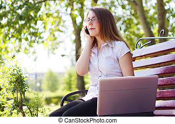 Business woman sitting on a bench