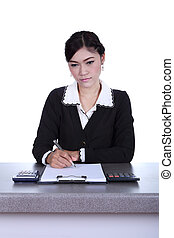 business woman sitting on her desk holding a pen working with do