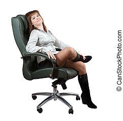 Business woman sitting on luxury office armchair