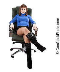 Business woman sitting on office armchair