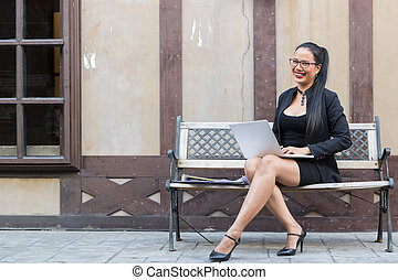 Business woman sitting Working outdoor