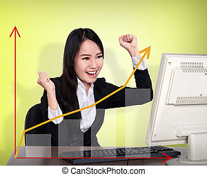 Business woman smile in front of her computer