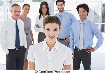 Business woman smiling at camera