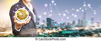 Business woman Stand and hold a magic ball with bitcoin. Concept electronic money in hand for future.
