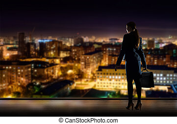 Business woman standing at the window