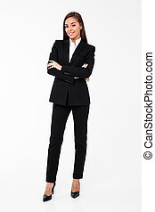 Business woman standing with arms crossed - Picture of...
