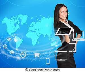 Business woman standing with tablet in hand on world map background