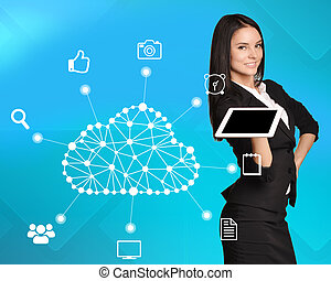 Business woman standing with tablet in his hand next to the cloud storage