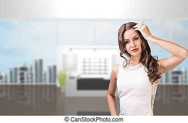Business woman stands in the office hall