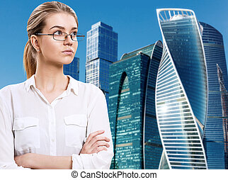 Business woman stands over cityscape background.
