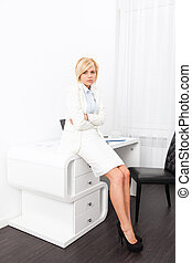 Business woman stomach ache sitting office desk - Business...