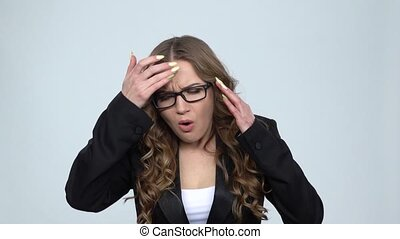 Business woman suffering from headache from fatigue against...