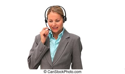 Business woman taking a phone call thanks to an headset