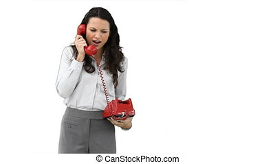 Business woman talking on a red telephone