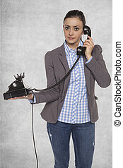 Business woman talking on an old phone