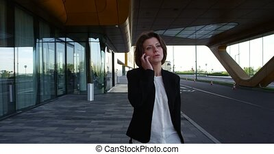 Business woman talking on phone - Mature business woman...
