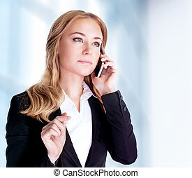 Serious woman talking on mobile phone near office building, proffesional conversation, smart businesspeople concept