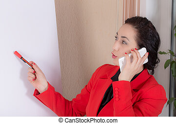 Business woman talking on the phone.