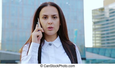 Business woman talking over a phone