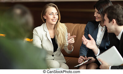 business woman talking to her business team