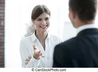 business woman talking with a colleague..