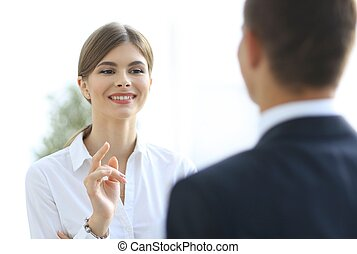 business woman talking with a colleague.. - young business...