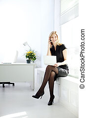 Business woman talks on the phone - Business Woman talking...