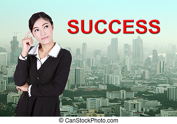 "business woman thinking about ""success"""