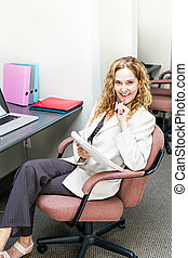 Business woman thinking at office desk