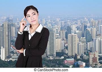 Business woman thinking with city