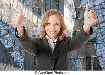 business woman thumbs up smiling