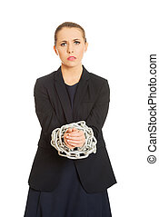 Business woman tied up with chain